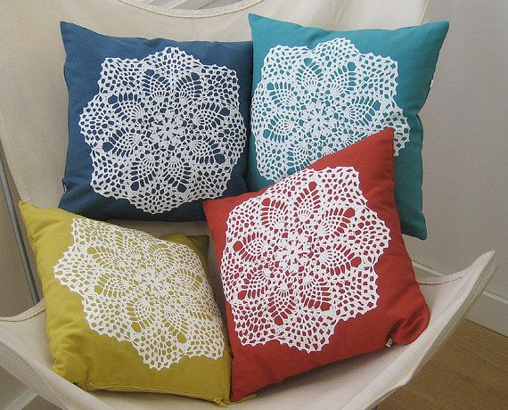 Not sure what to do with those hand me down doilies from Grandma? Sew them (or use fabric adhesive) to a brightly colored pillow to create instantly classic new home decor. Want the silk screened version? Get 'em here: https://www.etsy.com/listing/92703868/handmade-pillow-cover-hand-screenprinted?ref=favs_view_12