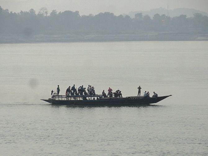 people on a ferry in Brahmaputra river.