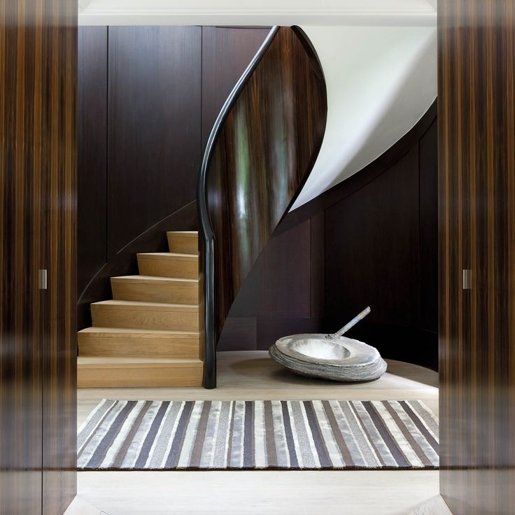 Featuring a striped design of black, grey and brown, add new dimension to a contemporary room.