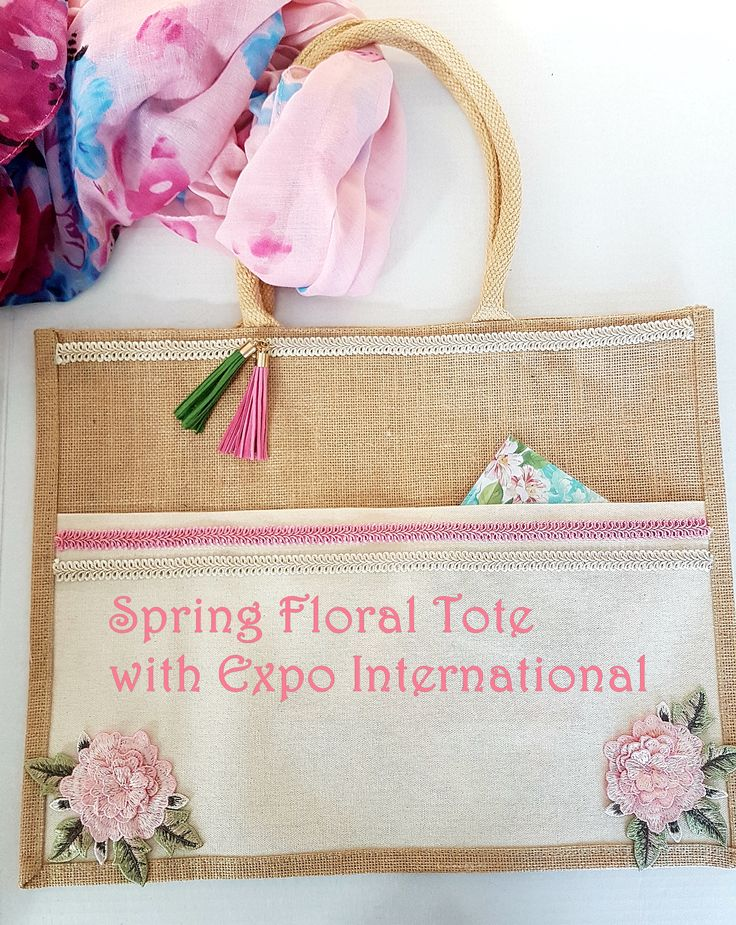 Running errands calls for a grab and go bag. Head into Spring with this pretty Spring Floral Tote. This one even has a front pocket! Start with a plain tote, some pretty trims and fabric glue. Have thirty minutes, you can put this pretty bag together and head out the door! #diytotebag #flowerappliquetote #tote #braidtrims #trims #expointernationaltrims. #crafttote