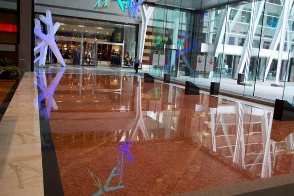 recently polished marble and granite floors showing beautiful Christmas lights in the reflection.