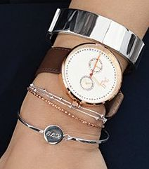 Mix your watch with wide and narrow bracelets to create a more raw look.