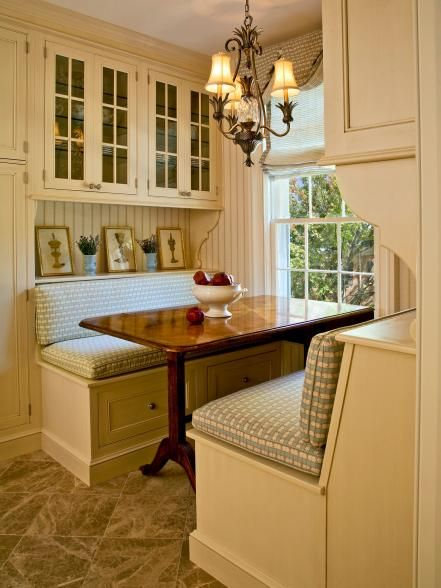 Booths and banquettes are most often associated with modern and contemporary spaces, but this quaint country kitchen looks super sweet with booth seating for four. On top of its charming appearance, this booth also boasts practicality with a pair of large drawers built into each side.