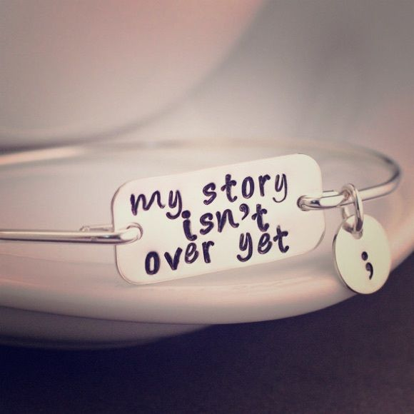 "My story isn't over yet - semicolon bracelet Never worn - Sterling silver - mental health awareness bracelet - ""my story isn't over yet"" with semicolon charm. Great gift for any loved one who has really mastered the art of struggle and found their way back to recovery <3 ... First two pictures are from etsy. Bracelet is not adjustable, but fits over small hand - is worn as a bangle. Jewelry Bracelets"