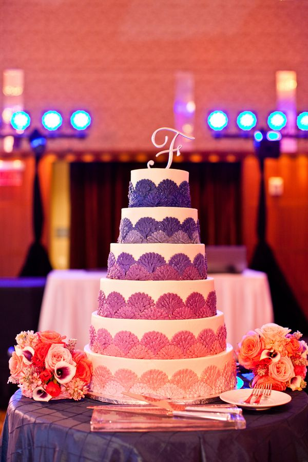 Tiered sunset themed ombre wedding cake with a monogram topper (Under Grace Photo)