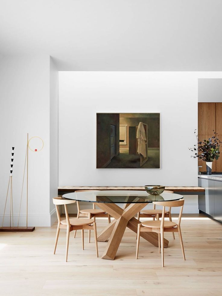 Dining table with glass top and light wood base toorak 2 house by robson rak photo by brooke holm