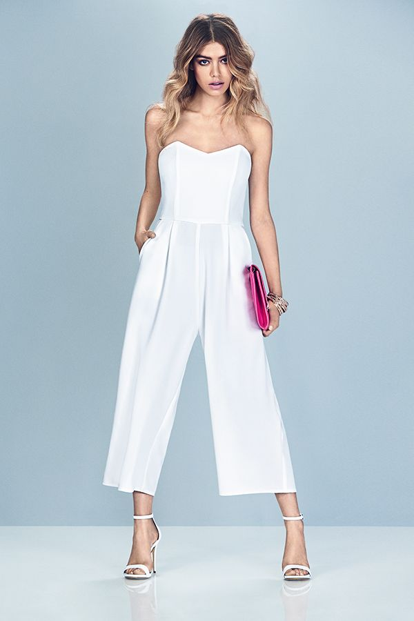 Add a pop of colour to a white jumpsuit with a neon clutch bag.