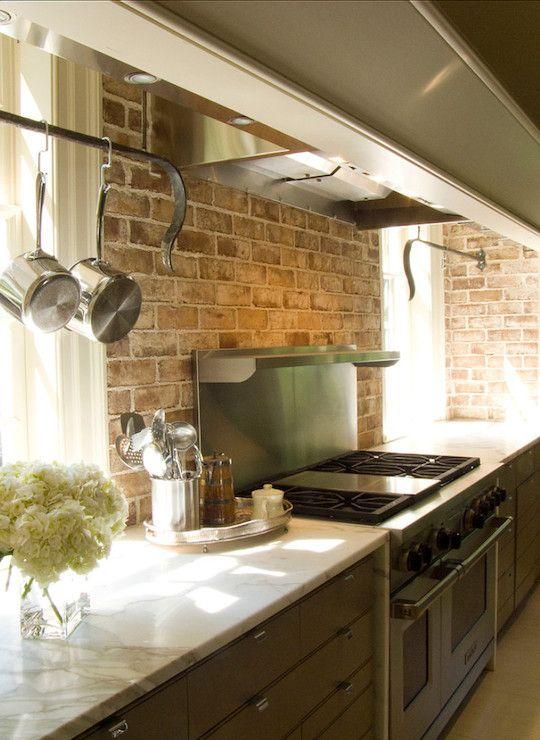 taupe cottage kitchen + exposed brick backsplash