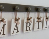 Personalized Housewarming Gift Hanging Wooden Letters Last Name with Pegs Painted Chocolate Brown. $49.00, via Etsy....but so easy to make...