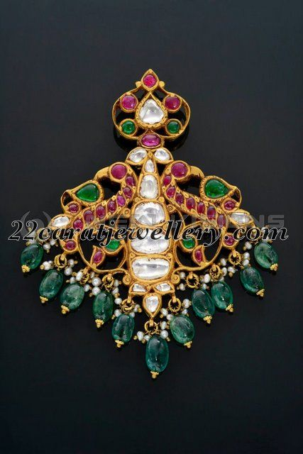 Designer peacock classy pendant in 22 carat gold metal. Studded with round pota rubies and large uncut diamonds, emerald drops, small basara...