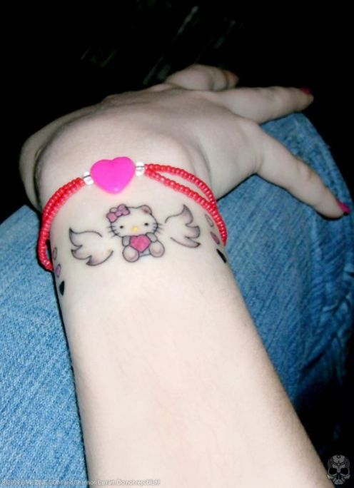Small kitty on wrist