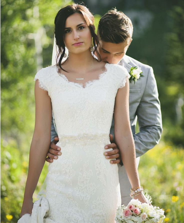 modest wedding dress with lace sleeves and a fitted skirt from alta moda. (modest bridal gowns)