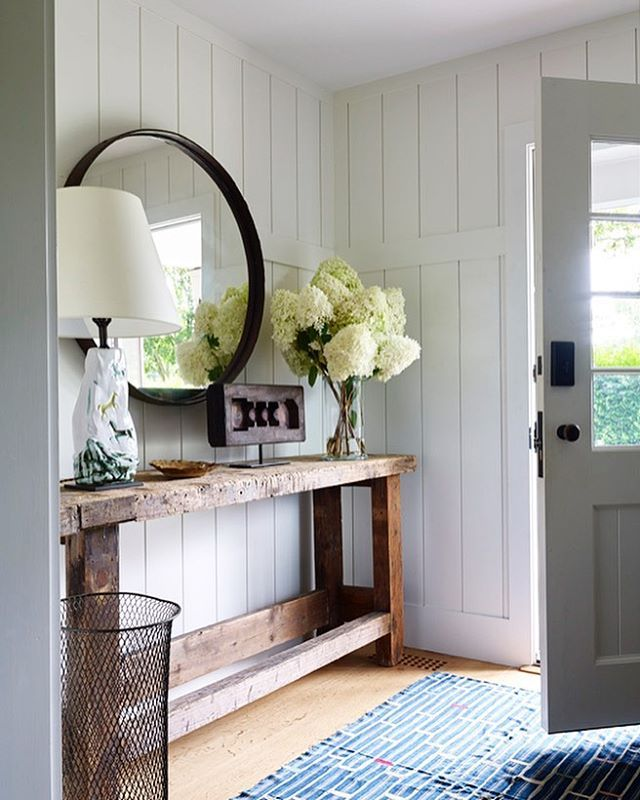 modern farmhouse entryway with reclaimed wood console round mirror and white shiplap walls styling with mirror wood decor and hydrangeas - Entryway Design Ideas
