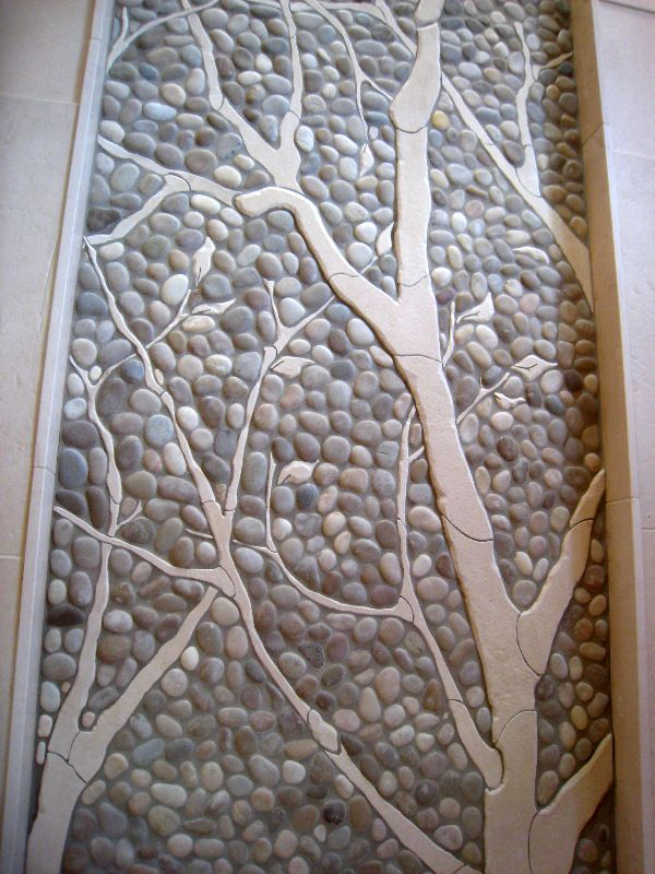 Insert clay structures into pebbles in a mosaic...interesting idea.
