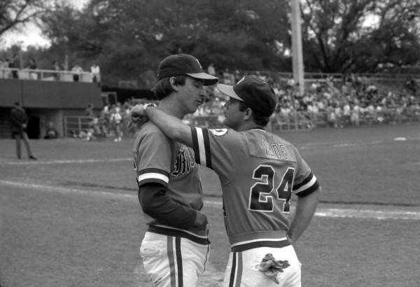 University of Miami baseball players talk on the sideline during the FSU vs Miami game (1985). | Florida Memory