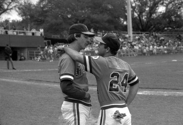 University of Miami baseball players talk on the sideline during the FSU vs Miami game (1985). | Florida Memory
