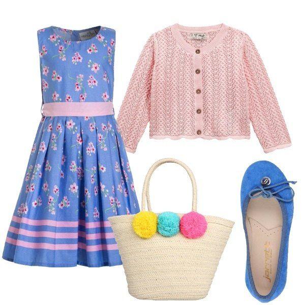 Outfit per una bimba romantica, che ama i colori pastello, i fiori e gli abiti. Vestito in cotone con fantasia floreale e cintura a contrasto rosa, maglioncino in cotone lavorato, ballerina in camoscio e simpatica borsa in paglia.