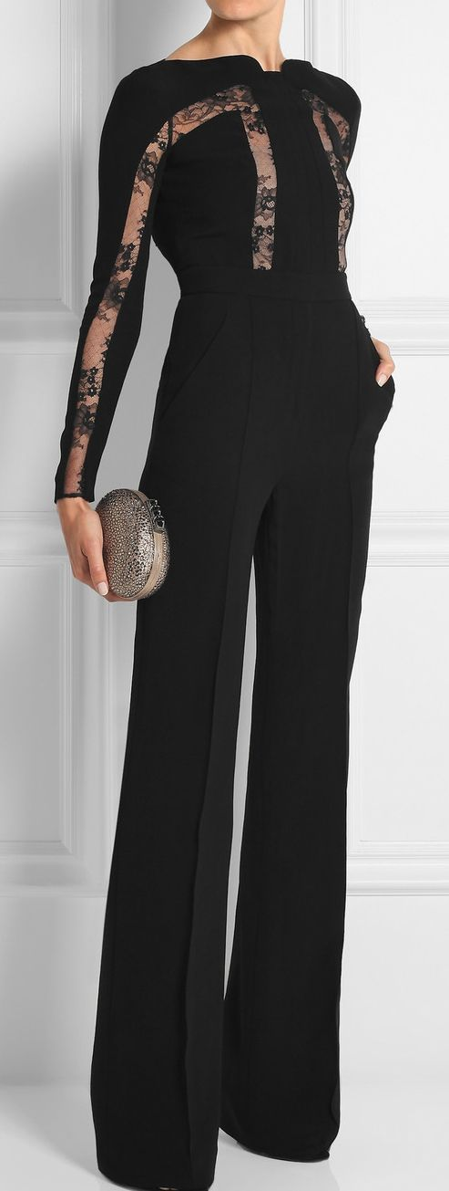Shop this look on Lookastic: https://lookastic.com/women/looks/black-lace-jumpsuit-silver-embellished-clutch/22865   — Black Lace Jumpsuit  — Silver Embellished Clutch