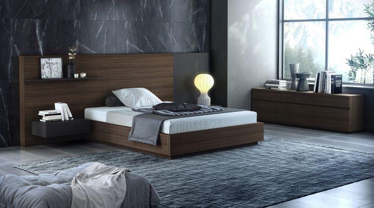 Delicadeza. Un dormitorio confortable, íntimo y elegante de roble fumé.