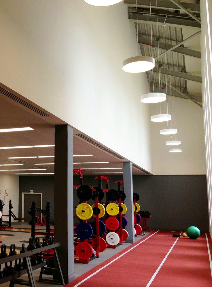 LAXA Pendants by Optelma, suspended direct/indirect lighting. #LightingDesign #Lighting #Gym #Office #Architecture #Fitness #InteriorDesign #LED #Pendant