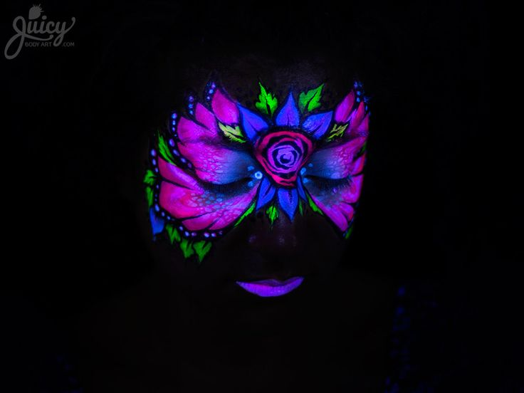 Bring on the night with fluoro face paint! It glows under a black light, and is perfect for teens and adults.  Art & Photography: Susanne Daoud  Model: Lola Digaletos