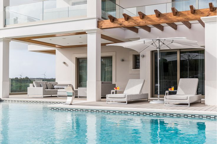 The interior of this modern new build villa was designed, manufactured and installed by Herrington Gate Furniture. Using striking contemporary man-made veneers such as Caledalegno makes this Portuguese villa stand out from any other on the luxury golf course of which it sits.