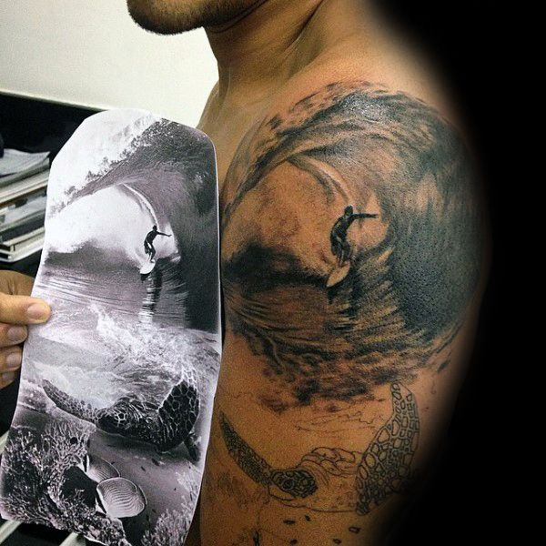 Male With Sea Creature And Shells And Surf Tattoo On Arms