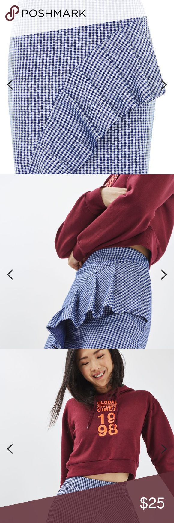 Top shop Gingham Ruffle Jersey Mini Skirt NWT Ruffles and gingham: the two super-trends we cant get enough of. Wear them combined in this statement mini skirt. We love how the ruffle detail travels from the side seam for a girlie touch. Mix it up with a graphic hoodie to finish the look. 51% Polyester, 49% Cotton. Machine wash. Navy blue and white color Topshop Skirts Mini