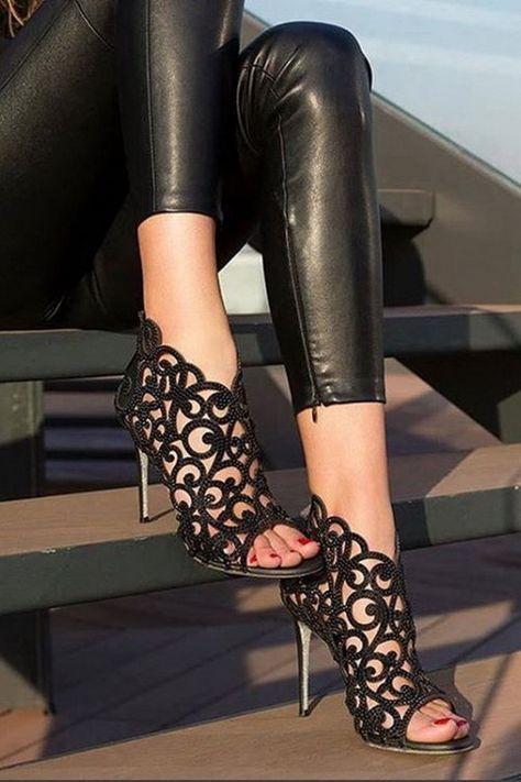Gorgeous Black Heels, don't wear in the sun unless you want patterned feet?