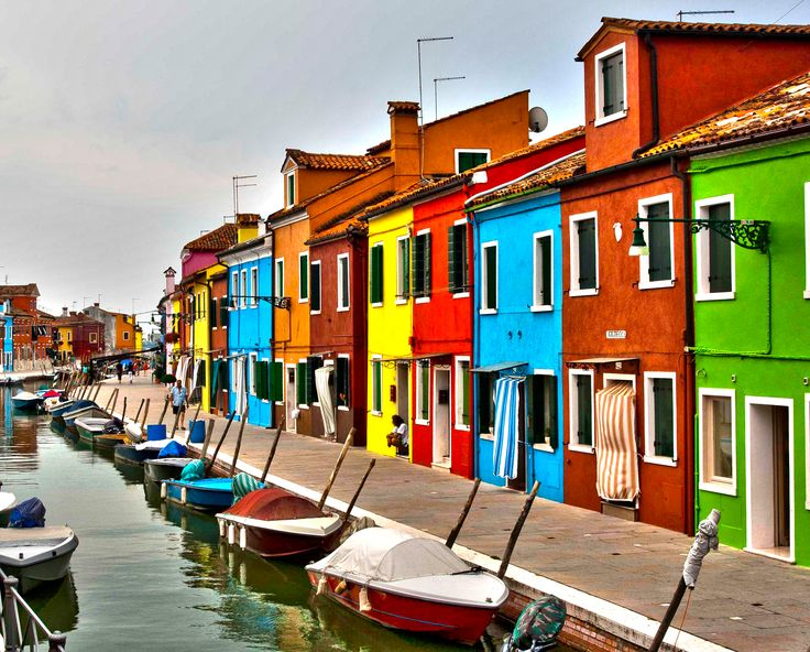 walk along the colorful homes & boats on Burano in Venice