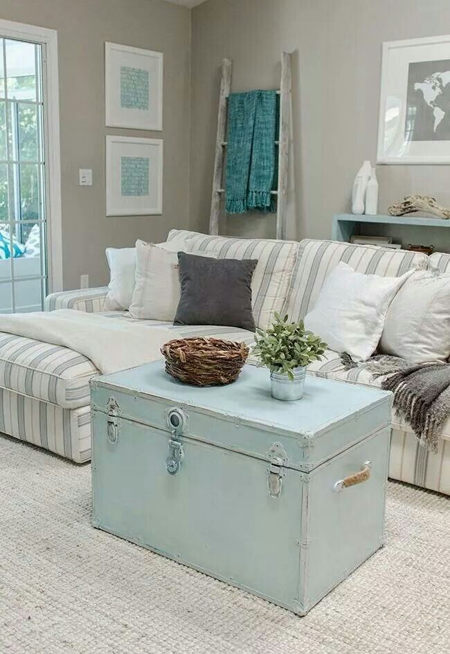 Now this is a coastal living room! The best part is, no matter where your home is, you can bring the feeling of the coast inside with this inspired decor!