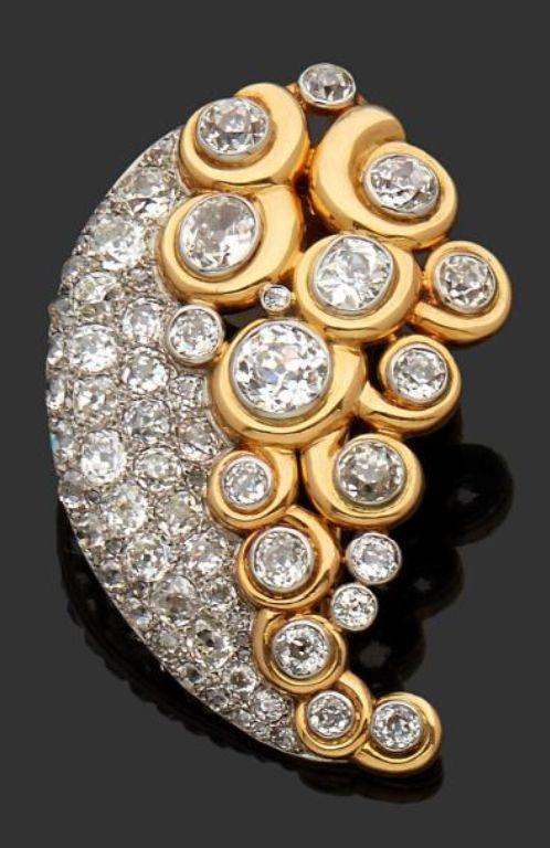 "SUZANNE BELPERRON - A VINTAGE GOLD, PLATINUM AND DIAMOND BROOCH ""FLEUR DE CACHMIRE"", CIRCA 1943. With maker's mark for Groëne & Darde."
