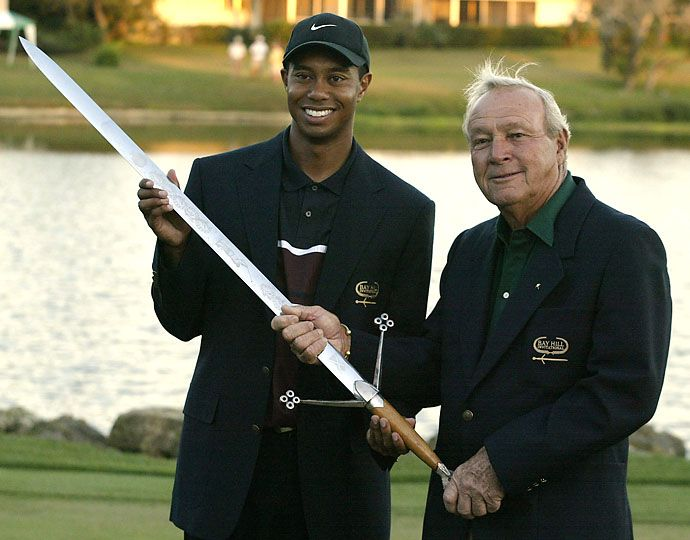 Tiger Woods and Arnold Palmer hold the Bay Hill Trophy after Woods won  the Bay Hill Invitational at the Bay Hill Golf Club and Lodge in Orlando, Florida. He shot a 3 under par 69 and finished at 13 under par.