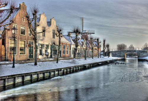 Little town called Sloten, Friesland...I recall this lighting at that time of year...I can almost smell the air! I miss the memories of Holland...