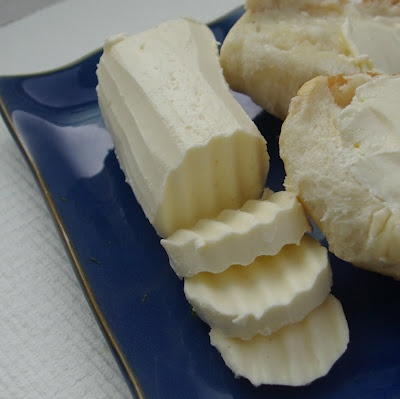 Cordell loves to make butter. We discovered making it, on accident, while making whipped cream. We usually just press the water out at the end, I will try this method next time and see how it works.