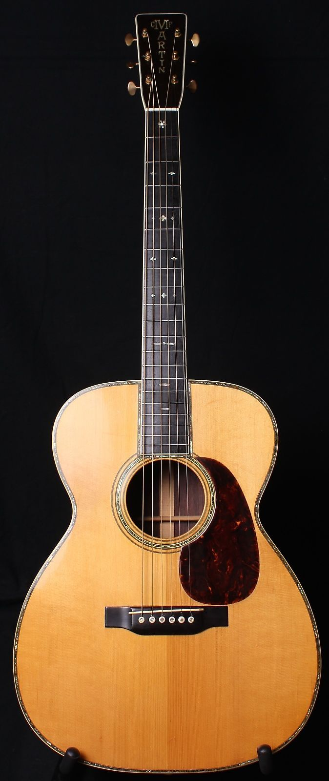 "Up for sale today is one of the finest acoustic guitars to ever come through our doors.  This is a 1934 Martin 000-45.  This is the first year that they were called 000, and this one still has the 25.4"" long scale length.  That makes this guitar a pickguard away from being a OM-45.  The guitar is..."