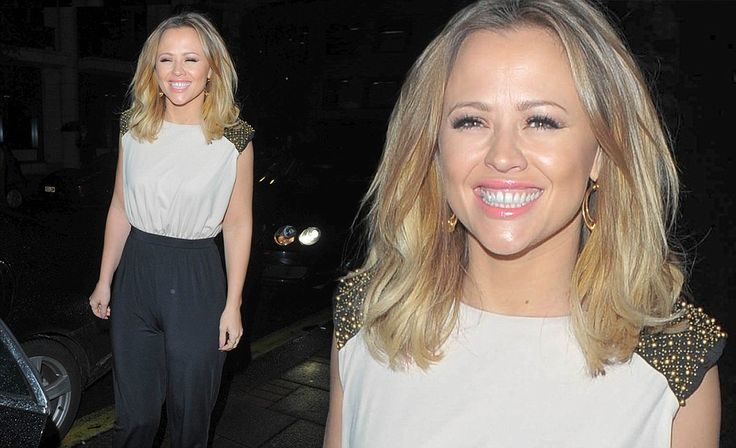 Kimberley Walsh wears a grey and black jumpsuit on night out in London
