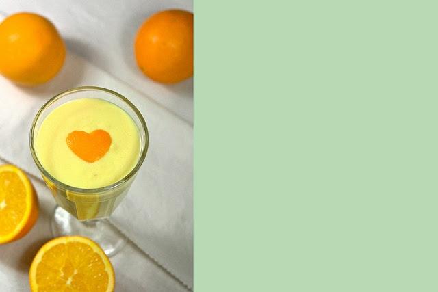 Pastel yellow mango smoothie with orange juice and honey. I want to ...