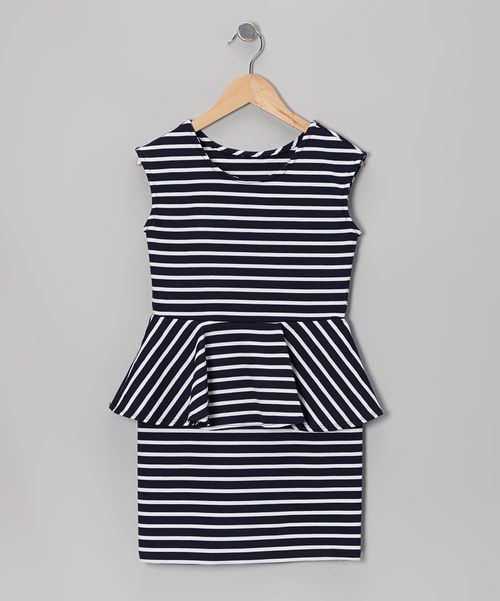 This elegant dress is made in the USA but flaunts European flair with a peplum silhouette, pleated skirting and a timeless look. This piece's comfy fit makes it as easy to put on as it is to pick out from a crowd.Polyester / rayon / spandexHand washMade in the USA