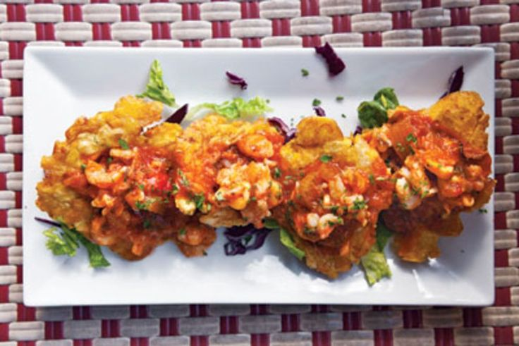 Tostones con Camarones Guisados (simple fried plantains topped with a bright shrimp and tomato sauce)