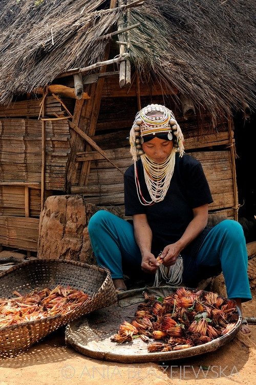 Burma/Myanmar |  Akha woman working near her house.  © Ania Blazejewska