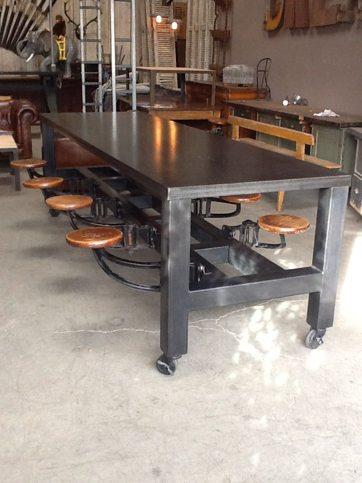 Custom steel table with vintage swing seats