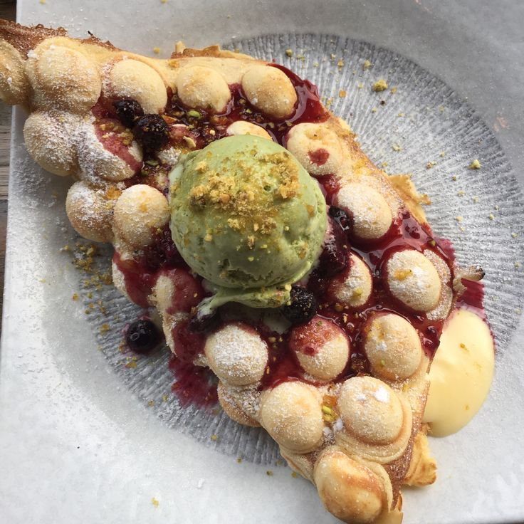 Custard waffle with berry compote, pistachio ice cream and honeycomb crunch - Baba Sus Glen Iris