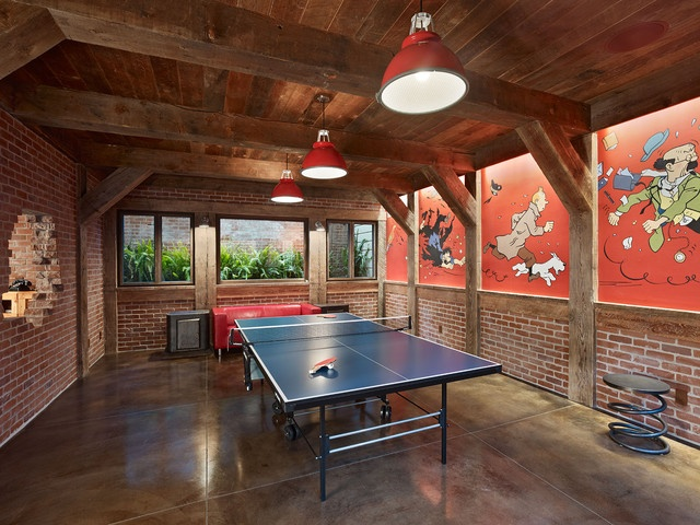 Love this for the basement - floors, wood ceiling and beams, wood and brick on walls, lights. (minus the comics painted on the walls, I love the wall color too). Great basement bar/rec room