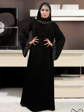 """Ghada Fashion Abaya (A) shape abaya made of crepe, sleeves drop wide, hand beaded around neck and cuffs.  Hijab (scarf) included size 65cm x 175 cm / 25.6"""" x 68.9"""" Fabric: Korean Crepe  Washing Instructions: Machine Wash Tailored and designed by """" Donia Abayas by Donia hand beaded, never two abayas are exactly identical"""