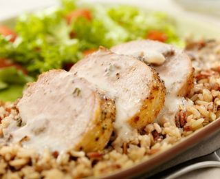 Pork with Garlic Cream Sauce - low carb - another great pork recipe for upscale dining! Use full fat cream cheese and whole cream instead of milk for less carbs.