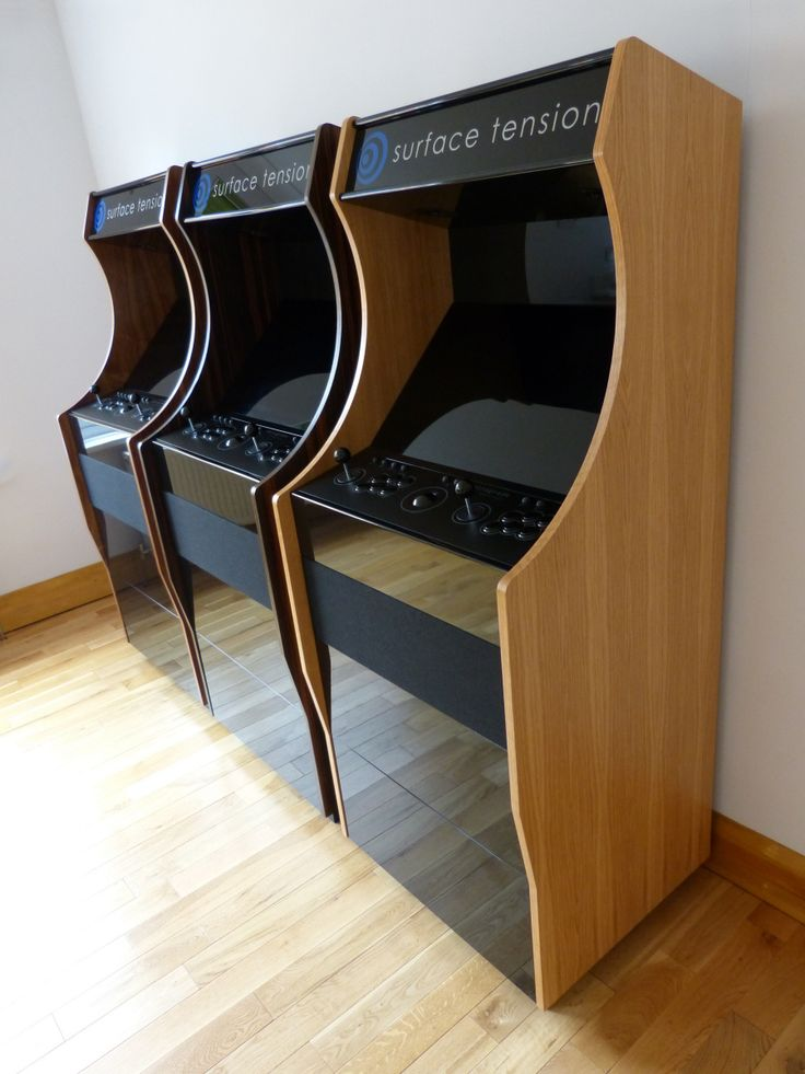 Retrograde stand up arcade machines in oak, macassar and walnut