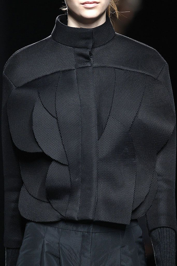 Innovative Pattern Cutting - black jacket with overlapping curved panels; creative sewing; fashion detail // Amaya Arzuaga F/W 2015