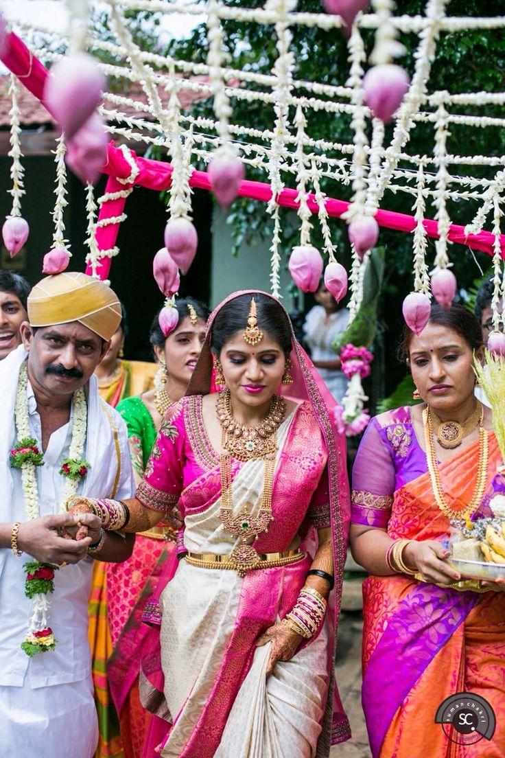 South Indian bride. Temple Indian bridal jewelry. Jhumkis.white and pink silk kanchipuram sari with pink blouse.Braid with fresh jasmine flowers. Tamil bride. Telugu bride. Kannada bride. Hindu bride. Malayalee bride.Kerala bride.South Indian wedding