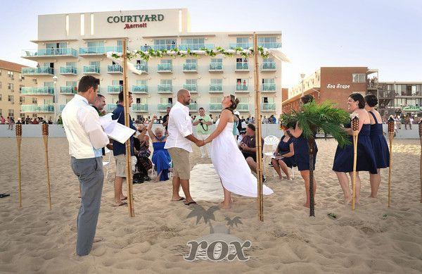 Beach Wedding in front of the Courtyard Marriott Hotel in Ocean City, MD by Rox Beach Weddings: http://roxbeach.com/